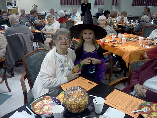 Every year members bring their children to play Bingo with the senior residents at Franciscan Village.